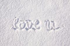 Aimez-vous écrit à la main dans la neige Photo stock