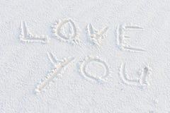 Aimez-vous écrit dans le sable blanc Photographie stock