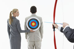 Aiming Arrow At Target On Businessman's Back Stock Images