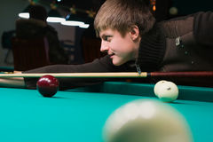 Aiming for billiard table Royalty Free Stock Image