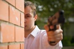 Aiming man Stock Photo