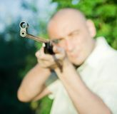 Aiming man Stock Photography
