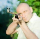 Aiming man Stock Photography