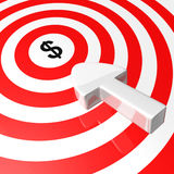 Aiming for the money. Arrow aiming for the money on a red and white target Royalty Free Stock Photography
