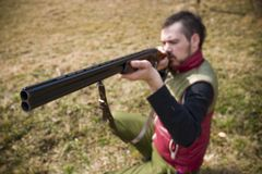 Hunter aiming rifle Royalty Free Stock Images