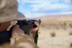 Aiming rifle in the desert Royalty Free Stock Photos