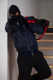 Aiming robber with bag. A masked robber with bag aiming at you royalty free stock photos