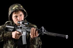 Aiming soldier with a rifle Stock Images