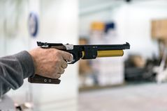 Aiming the target and Shooting with Pistol Royalty Free Stock Images
