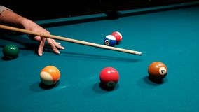 Aiming white ball - pool after shot. Focus on white ball - playing pool Stock Image
