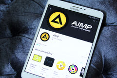 Aimp audio player app. Downloading aimp audio player application from google play store on samsung tablet Royalty Free Stock Photography