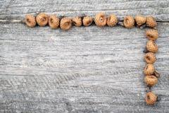 Ainda composição da vida com cones do pinho e as varas de madeira Imagem de Stock Royalty Free