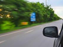 Ainda conduzindo na maneira da altura Imagem de Stock