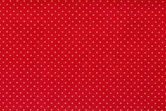 Ainda fim da vida acima do detalhe de um peda?o de papel vermelho brilhante com os ?s bolinhas brancos alinhados e a textura foto de stock royalty free