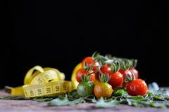Ainda grupo da vida de tomate na madeira velha Imagens de Stock Royalty Free