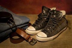 Ainda sapatas pretas da vida, botas Imagens de Stock