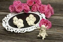 Ainda vida com anjos e flores Fotografia de Stock