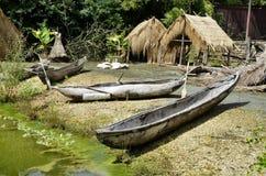 Ainda vida com barcos e cabanas Imagem de Stock Royalty Free