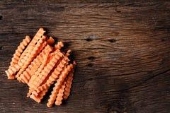 Ainda vida com a cenoura em de madeira Foto de Stock
