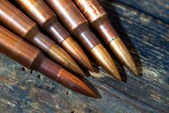 Ainda vida com diversos cartuchos do rifle Foto de Stock