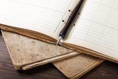 Ainda-vida com escrita-livros velhos Foto de Stock Royalty Free