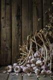 Ainda a vida com galics, abóbora e seca flores pequenas no fundo de madeira da tabela Imagem de Stock Royalty Free