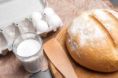 Ainda vida com leite, ovos, pão Imagem de Stock