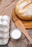 Ainda vida com leite, ovos, pão Fotografia de Stock