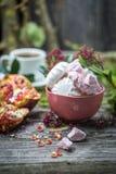 ainda vida com marshmallows e romã Fotos de Stock