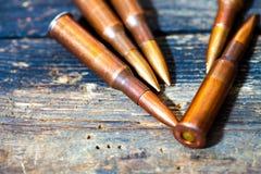 Ainda vida com os cinco cartuchos do rifle Fotografia de Stock