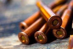 Ainda vida com os cinco cartuchos do rifle Imagens de Stock