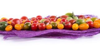Ainda vida com os tomates diferentes da cor Imagem de Stock