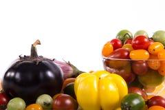 Ainda vida com os tomates e beringelas diferentes da cor Fotos de Stock