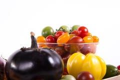 Ainda vida com os tomates e beringelas diferentes da cor Imagem de Stock