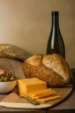 Ainda vida com queijo e pão da salsicha Imagem de Stock