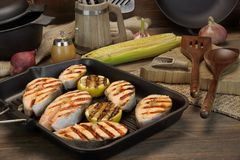 Ainda vida com Salmon Steaks In Rustic Style grelhado Imagem de Stock Royalty Free
