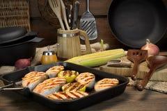 Ainda vida com Salmon Steaks In Rustic Style grelhado Fotos de Stock Royalty Free