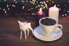 Ainda vida com um copo e velas de café Fotos de Stock Royalty Free