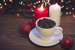 Ainda vida com um copo e velas de café Foto de Stock Royalty Free