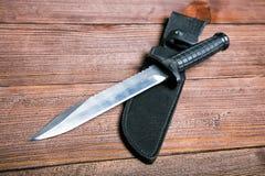 Ainda vida com uma faca e um bandolier Imagem de Stock