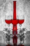 Ainda vida com uma garrafa e vidros do vidro com vinho Imagens de Stock