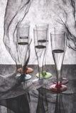 Ainda vida com vidros altos e o pano transparente Imagens de Stock Royalty Free