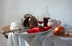Ainda vida com vinho tinto e pimentas vermelhas Foto de Stock Royalty Free