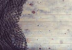 Ainda-vida das redes de pesca no fundo de madeira Fotos de Stock Royalty Free
