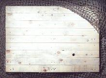 Ainda-vida das redes de pesca no fundo de madeira Foto de Stock Royalty Free