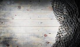 Ainda-vida das redes de pesca no fundo de madeira Imagem de Stock Royalty Free