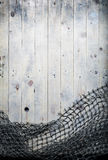 Ainda-vida das redes de pesca no fundo de madeira Imagens de Stock Royalty Free