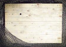 Ainda-vida das redes de pesca no fundo de madeira Imagens de Stock