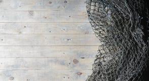 Ainda-vida das redes de pesca no fundo de madeira Imagem de Stock
