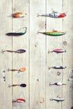 Ainda-vida do equipamento de pesca no fundo de madeira Imagem de Stock Royalty Free